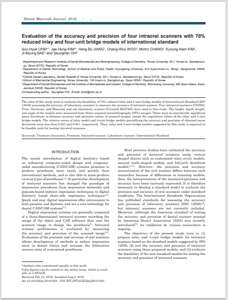 Evaluation of the accuracy and precision of four intraoral scanners with 70% reduced inlay and four-unit bridge models of international standard