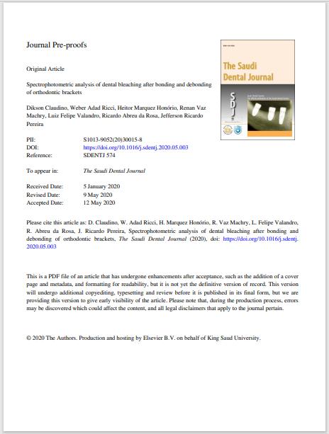 Spectrophotometric analysis of dental bleaching after bonding and debonding of orthodontic brackets
